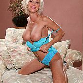 Enchanting breasty mama Cara Lott performs her superlatively good striptease.